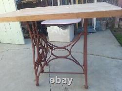 Antique sewing machine butcher block table