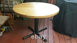 Dining round wood table-42 with oak butcher block top and iron pedestal
